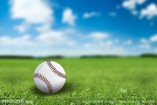 baseball_on_green_field_sjpg12535.jpg